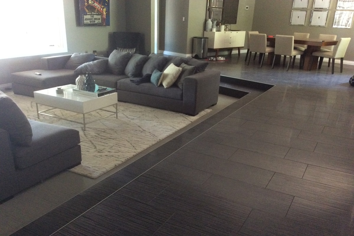 Sunken Living Room Idea With Laminate Flooring And Area Rug