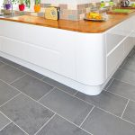 Modern Kitchen Remodel and Design with Laminate Countertops and Stone Tile Flooring